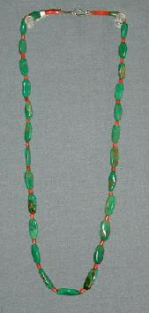 Turquoise with Red Coral Beads and other Southwestern Indian Made Jewelry can be found at The Native American Trading Company in Denver Colorado.